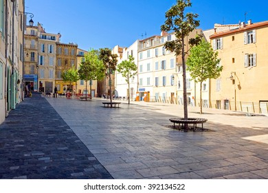 Marseilles, France - April 29, 2006: People and traditional stores in the main square of the old district Le Panier