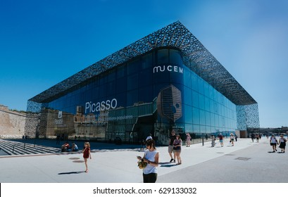 MARSEILLES, FRANCE - JUNE 22, 2016: Tourists and local people walking in front of the modern building of Museum of European and Mediterranean Civilizations (MuCEM).