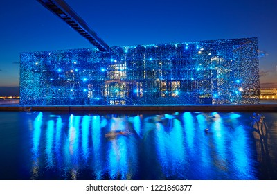 MARSEILLES PROVENCE FRANCE - 7TH JULY 2014; Facade of the MuCEM (Museum of European and Meditereanean Civilisations) at night in the redeveloped port of Marseille, architect Rudy Ricciotti