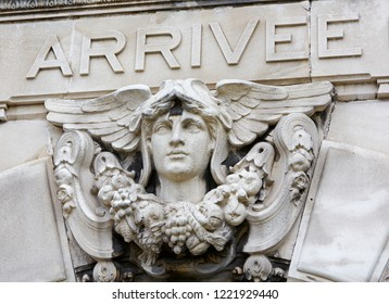MARSEILLES PROVENCE FRANCE - 7TH JULY 2014; Architectural detail of bust on the facade of the arrivals hall of Marseilles with ARRIVEE sign (Arrival)