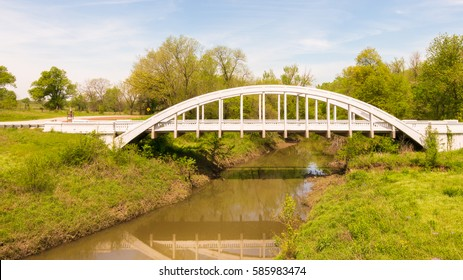 """""""Marsh Arch"""" bridge reflection in Brush Creek, the only remaining one on Route 66, Riverton, Kansas  Route 66 '13 - DAY 4 Springfield, MO to Oklahoma City, OK, Rainbow Arch Bridge"""