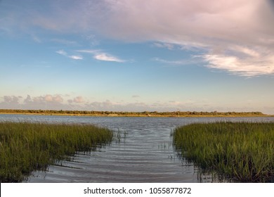 Marsh inlet at sunset coastal north carolina blue and orange gradient with pink clouds