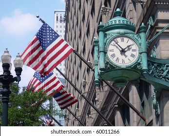 Marshall Field's clock over american flags on State Street in Chicago, USA