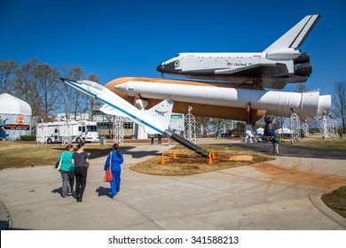 Marshall Space Flight Center, Alabama - April 12th 2014 - Tourists enjoying a  blue sky day at the Marshall Space Flight Center in Alabama, USA