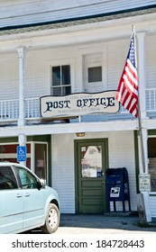 Marshfield, VT, USA - October 1, 2013: A car is parked in the handicapped space outside the Marshfield, VT town post office on a sunny afternoon.