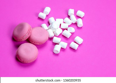 marshmallow candy with macaroons on a pink background