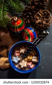 Marshmallow and milk on christmas. Cones and decoration