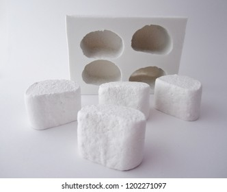 Marshmallow Mold and Handmade White Chamallow Resin Molding Isolated On White Background