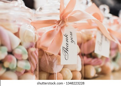 Marshmallow sweets in a transparent jar with a Thank You message around the neck of jar as a Birthday party return sweet treat