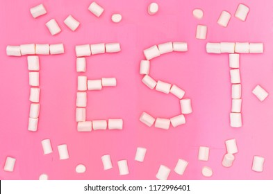Marshmallow Test - Word Test build with Marshmallow on pink background