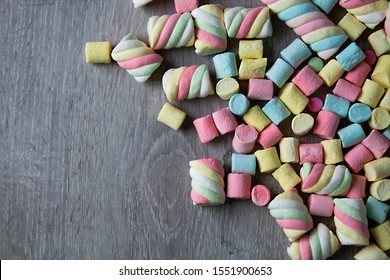 Marshmallows. Background or texture of colorful mini marshmallows. on a gray background,  With space to write titles, information or expressive words, - Image