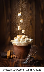 marshmallows falling into cup with hot chocolate or cocoa