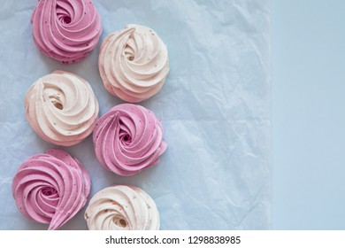 marshmallows and macaroons on blue background
