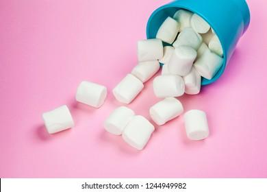 Marshmallows on pink background