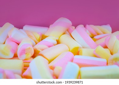 Marshmallows on the pink background, closeup