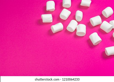 marshmallows on a pink background. top view