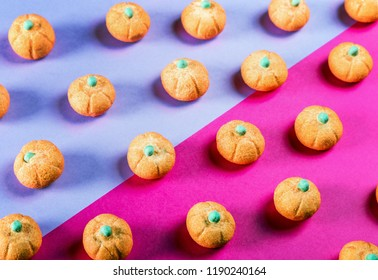 marshmallows in the shape of a pumpkin for the holiday Halloween on a purple background. pastel shade