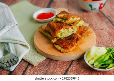 Martabak Telor or Martabak egg. Savory pan-fried pastry stuffed with egg, meat and spices. Martabak Telur is one of Indonesia street food