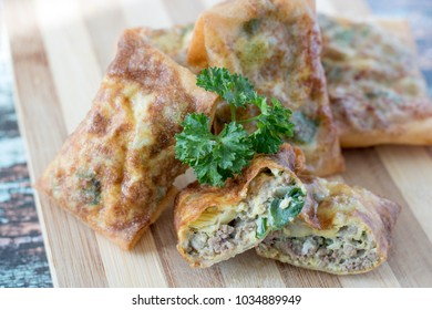 Martabak telur mini, Indonesian street food. fried wrap filled with eggs,minced meat, and vegetables.
