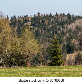 Martakov kopec hill with lookout tower above Petranky settlement in springtime Javorniky mountains in Slovakia