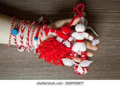 Martenitsa, white and red strains of yarn, Bulgarian folklore tradition, welcoming the spring in March, adornment symbol, wish for good health. Baba Marta Day. UNESCO List Cultural Heritage Humanity.