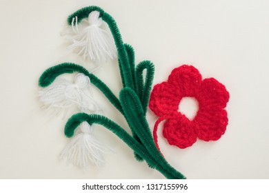 Martenitsa, white and red strains of yarn, Bulgarian folklore tradition, welcoming the spring in March, handcraft pendant symbol, crochet flowers tassel snowdrops, wish for good health. Baba Marta Day