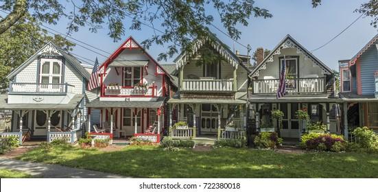 MARTHA'S VINEYARD, MA, USA - SEP 26, 2017: Carpenter Gothic Cottages with Victorian style, gingerbread trim on Lake Avenue, Oak Bluffs on Martha's Vineyard, Massachusetts, USA.