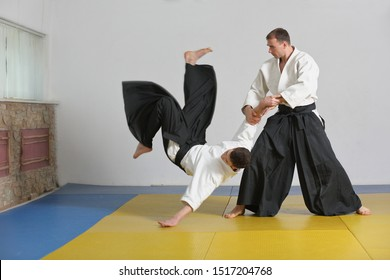 Martial art of Aikido . the athlete demonstrates the technique of Aikido on the tatami in dojo .
