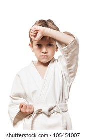 Martial art sport - child boy in white kimono training karate punch