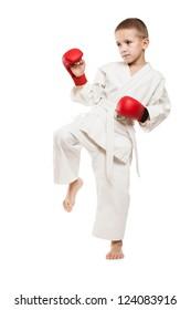 Martial art sport - child boy in white kimono training karate punch or kick