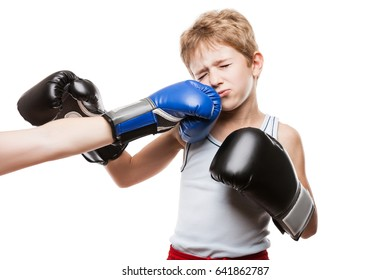 Martial art sport fail and lose concept - handsome boxer child boy in boxing gloves got punched