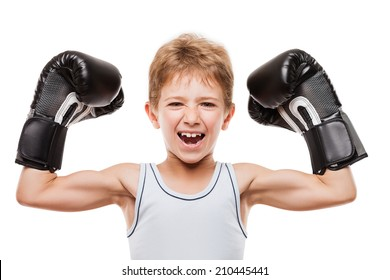 Martial art sport success and win concept - smiling boxing champion child boy gesturing for first place victory triumph