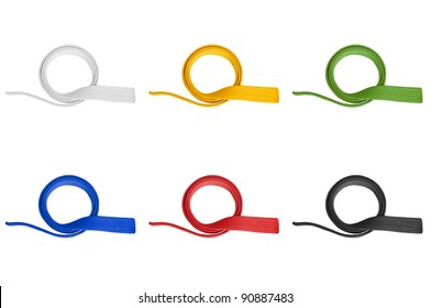 Martial arts belts in various colors isolated on white background