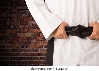 Martial arts black belt of taekwondo suit.