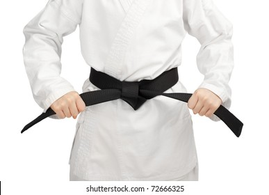 Martial arts boy tying the knot to his black belt