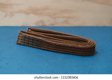 Martial Arts Brown Belt Brazilian JiuJitsu folded on mat