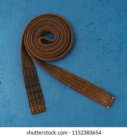 Martial Arts Brown Belt Brazilian JiuJitsu coiled up top view