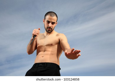 martial arts instructor exercising with a knife outdoor