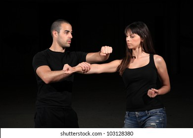 martial arts instructor exercising with young girl