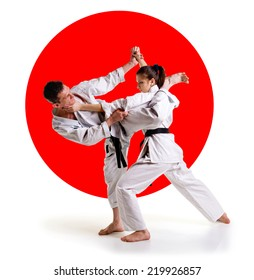 Martial arts master.Karate athletes on the background of the Japanese flag on a  white background.Sports Scramble.