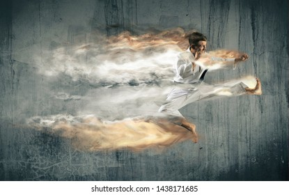 Martial arts masters, karate practice. On wall background