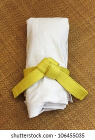 Martial Arts uniform with yellow belt on Tatami