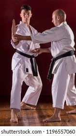 Martial karate instructor teach to a kid.