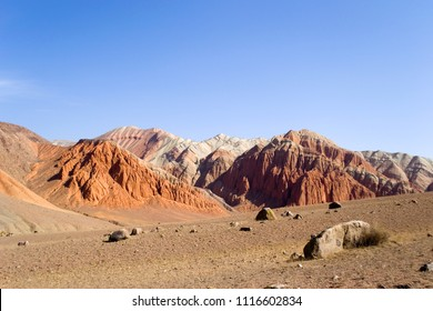 Martian landscape on earth. Mars on earth. Red rocks and a lifeless desert under the blue sky. Kyrgyzstan