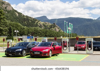 MARTIGNY, SWITZERLAND - JUNE 29, 2016: Two Tesla model S cars charging their battery with the Tesla supercharger in the Grand St Bernard relais in Martigny.