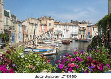 Martigues (Bouches-du-Rhone, Provence-Alpes-Cote d'Azur, France): the old harbor with boats and flowers