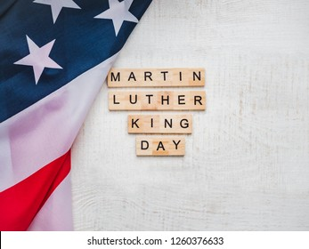 Martin Luther King, Jr. Day. Beautiful greeting card. White isolated background, close-up, top view, wooden surface. Congratulations for loved ones, relatives, friends and colleagues