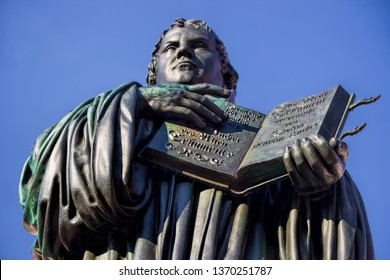 Martin Luther monument with bible in Wittenberg, Germany
