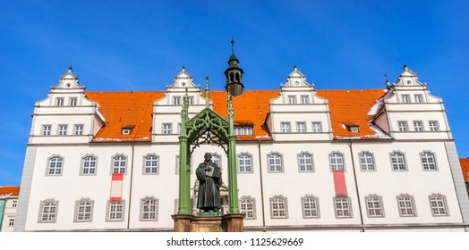 Martin Luther Statue, Colorful Market Square Rathuas Lutherstadt Wittenberg Germany. Statue from 1800s.