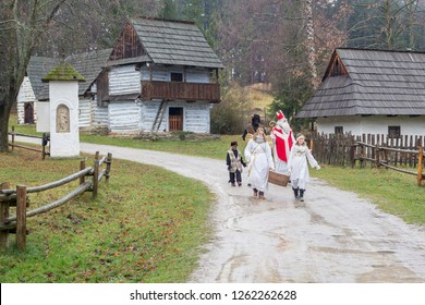 MARTIN, SLOVAKIA, December 09, 2018: Slovak National Museum in Martin – Museum of the Slovak Village - Saint Nicholas, devil and angel - Slovak folk christmas tradition. EDITORIAL.